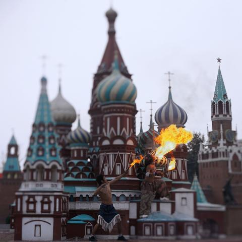 Two artists performing in a mini replica of Moscow Kremlin in Beijing World Park, in suburb Beijing.