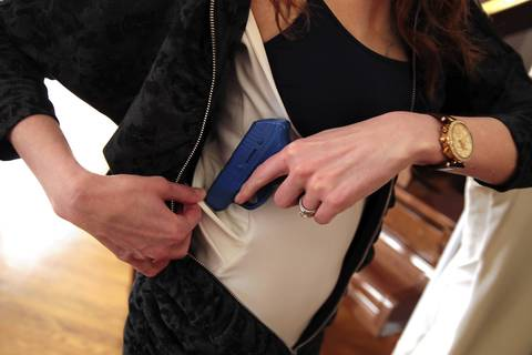 Marilyn Smolenski demonstrates the pockets in her concealed carry camisole.