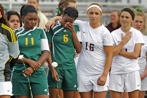 Staff Photo Of The Week: May 3-May 9, 2014 Poquoson's Reilly Jackson, center, comforts Bethel's Destinee Goodwin during the national anthem before the start of Wednesday's game at Poquoson. To the left is Bethel's Raesha Jackson and to the right is Poquoson's Leslie Speight.