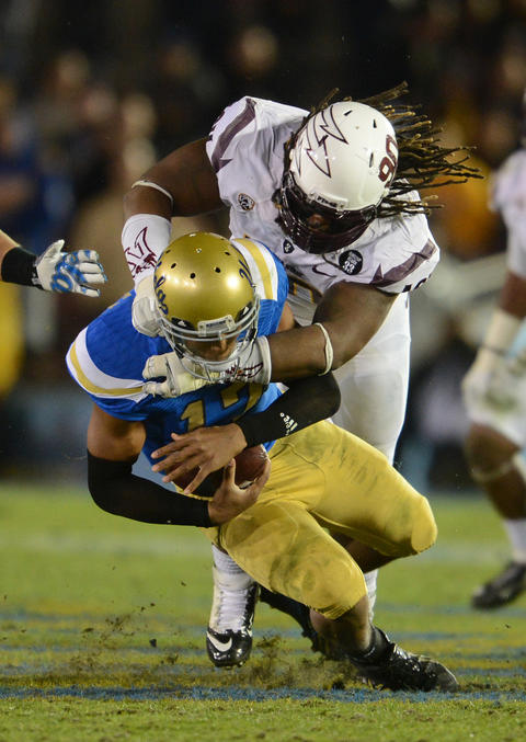 Arizona State Sun Devils defensive tackle Will Sutton (90) sacks UCLA