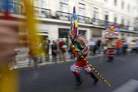 Participants perform during the parade of the 9th International Festival of the Iberian Mask in Lisbon May 10, 2014. The festival runs until next Sunday and about 450 masked people from Spain, Portugal and Italy are participating.