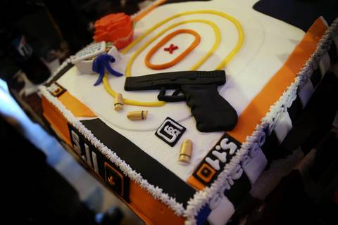A cake promotes 5.11 Tactical clothing company at the Firearms & Fashion Show at Firewater Saloon in Chicago's Edison Park neighborhood.