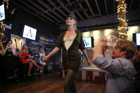 Model Heather Wilson walks the runway in a dress that hides a gun during the Firearms & Fashion Show at Firewater Saloon in Chicago's Edison Park neighborhood.
