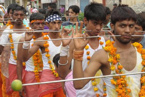 Indian Hindu devotees walk with steel rod piercings through their cheeks during a procession to honour the Hindu goddess Maha Mariamman (Sheetla Mata), to mark Mother's Day, in Amritsar on May 11, 2014 . Devotees believe that the goddess protects whoever worships her.