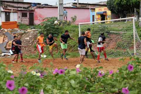 """Residents play a Sunday """"pelada"""" soccer match in the Bom Pastor neighborhood of Natal, a World Cup host city, May 11, 2014."""