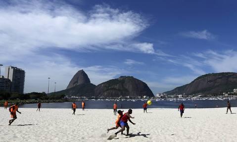 "A view of a Sunday ""pelada"" soccer match on Botafogo beach in Rio de Janeiro, a World Cup host city, May 4, 2014."