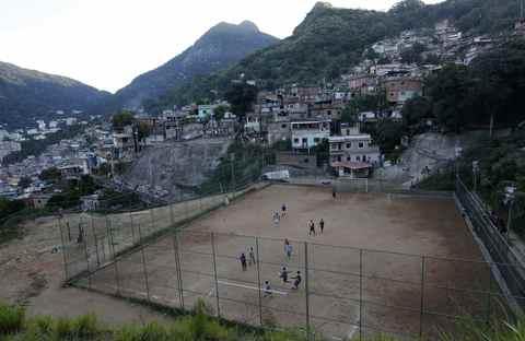 "A view of a Sunday ""pelada"" soccer match in the Borel favela of Rio de Janeiro, a World Cup host city, May 4, 2014."