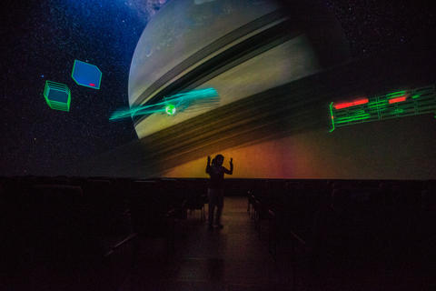 "Becky Poole, is acting as a tour guide ""Jesse"" in a production of ""Destination Solar System,"" the new Adler Planetarium show in its main theater."