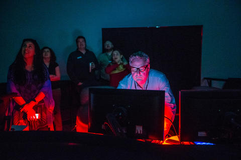 "Mark Webb runs the projectors during production screening of ""Destination Solar System,"" the new Adler Planetarium show."