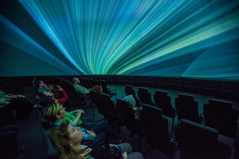 "Spectators look at Saturn's rings during a production screening of ""Destination Solar System."""