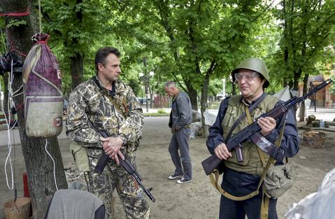 Armed pro-Russian protesters guard a barricade in Lugansk, Ukraine, on May 13.