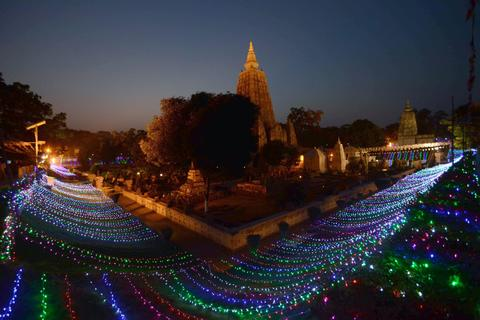World Heritage site, the Mahabodhi Temple is illuminated with lights on the occassion of the 2558th Buddha Jayanti celebrations at Bodhgaya on May 12, 2014.