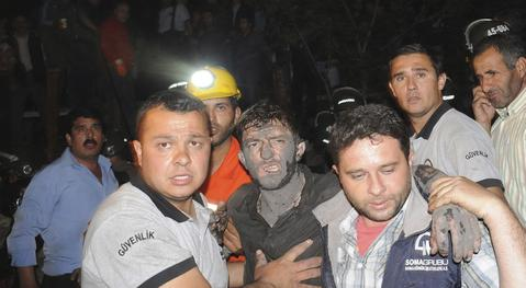 An injured miner is carried to an ambulance in Soma, a district in Turkey's western province of Manisa May 13, 2014. An explosion and fire in the coal mine in western Turkey killed at least seventeen miners on Tuesday and may have trapped as many as 300 more, officials said.