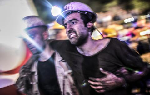 "An injured miner came out carried by rescuers, on May 13, 2014 after an explosion in a coal mine in Manisa. At least 157 miners were killed in collapsed coal mine in the western Turkish city of Manisa. ""At least 200-300 workers were working in the mine when an electric fault caused an explosion,"" the mayor of Soma, a district of Manisa, told private NTV television."