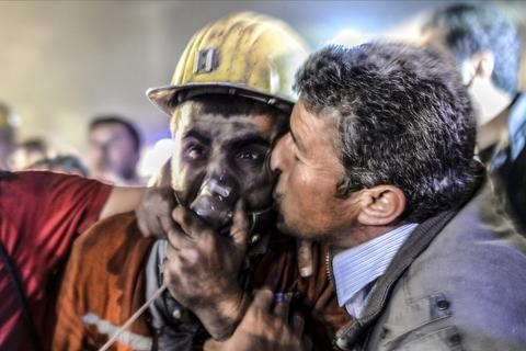 "A man kisses his son, rescued of the mine, on May 13, 2014 after an explosion in a coal mine in Manisa. At least 157 miners were killed in collapsed coal mine in the western Turkish city of Manisa. ""At least 200-300 workers were working in the mine when an electric fault caused an explosion,"" the mayor of Soma, a district of Manisa, told private NTV television."