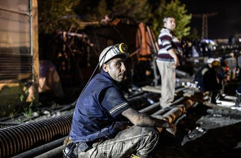 "A miner wait for his friends outside of a mine after an explosion in Manisa on May 13, 2014. Four miner were killed and as many as 300 trapped after a mine collapse in the western Turkish city of Manisa, a local official said. ""At least 200-300 workers were working in the mine when an electric fault caused an explosion,"" the mayor of Soma, a district of Manisa, told private NTV television."