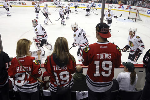 Blackhawks fans cheer on their favorite players during warmups.