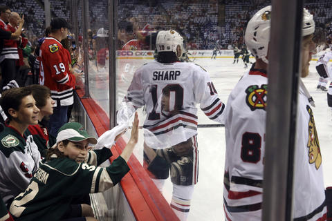 A young Wild fan says bangs on the glass to get the attention of Marian Hossa.