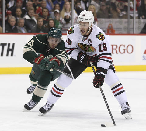 Jonathan Toews attacks the Wild's Jonas Brodin during the first period.