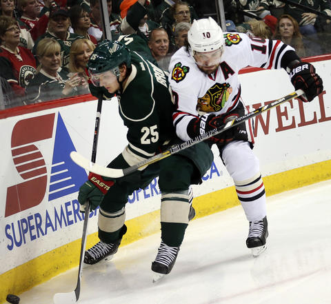 Patrick Sharp fights for a puck with the Wild's Jonas Brodin during the second period.