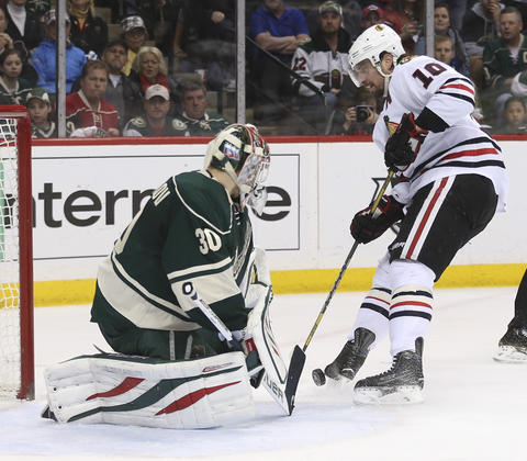 Wild goalie Ilya Bryzgalov blocks a shot by Patrick Sharp on a breakaway in the second period.
