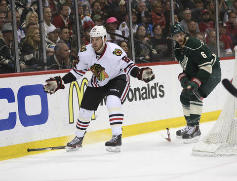 Bryan Bickell pleads with the ref after a broken stick on a play with the Wild's Marco Scandella during the second period.