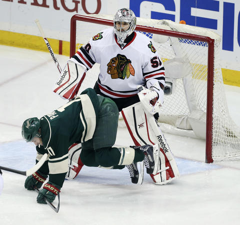 Blackhawks goalie Corey Crawford tends to his goal in the third period.
