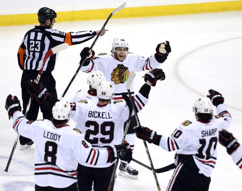 Patrick Kane celebrates with teammates after his game-winning goal in overtime.