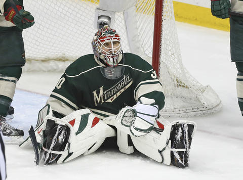Wild goalie Ilya Bryzgalov sits on the ice during overtime.
