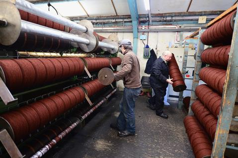 Lewis Miller dying wool at the Harris Tweed Hebrides Company in Shawbost on May 13, 2014 in Stornoway, Scotland.