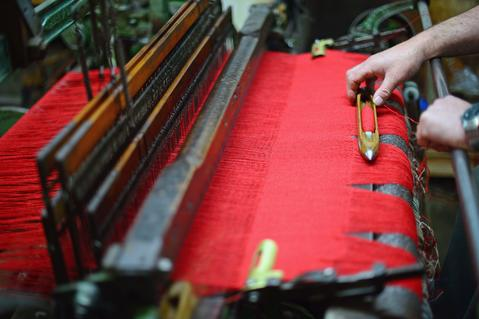 Malcolm John Macleod works on Hattersley single width loom at the Harris Tweed Hebrides Company in Shawbost on May 13, 2014 in Stornoway, Scotland.