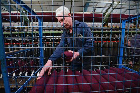 John Mackay works on a spinning frame at the Harris Tweed Hebrides Company in Shawbost on May 13, 2014 in Stornoway, Scotland.