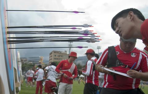 China's Chengjie Ma looks at his arrows during  the Archery World Cup Recurve Bow Men qualification on May 14, 2014 in Medellin, Antioquia department, Colombia.
