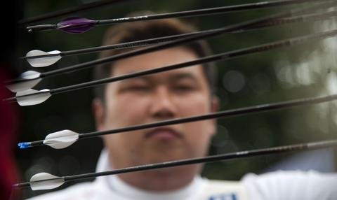 Korean Oh Jin Hyek  looks at his arrows  during  the Archery World Cup Recurve Bow Men qualification on May 14, 2014 in Medellin, Antioquia department, Colombia.
