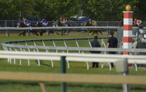 California Chrome leads the field heading into the fourth turn of the 139th Preakness at Pimlico Race Course.