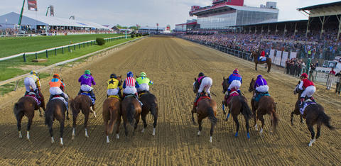 California Chrome, third from left, leads the 10 horses out of the starting gate for the 139th Preakness at Pimlico Race Course.