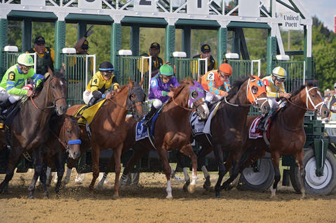 California Chrome, third from right, leads the horses out of the starting gate in the 139th Preakness at Pimlico Race Course.