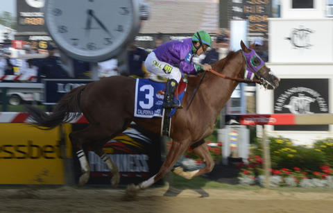 California Chrome wins the 139th Preakness at Pimlico Race Course.