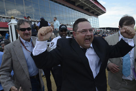 Alan Sherman, the assistant trainer for California Chrome, celebrates after the horse won the 139th Preakness at Pimlico Race Course.