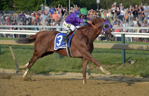 California Chrome races down the stretch to win the 139th Preakness at Pimlico Race Course.