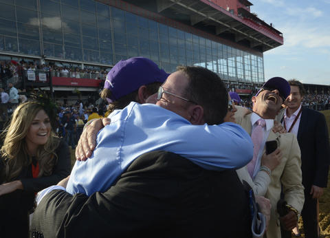 Alan Sherman, right, assistant trainer of California Chrome, celebrates after the horse won the 139th Preakness at Pimlico Race Course.