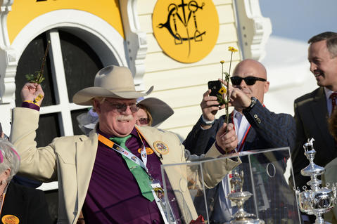 Steve Coburn, co-owner of California Chrome, celebrates the horse's victory in the 139th Preakness at Pimlico Race Course.