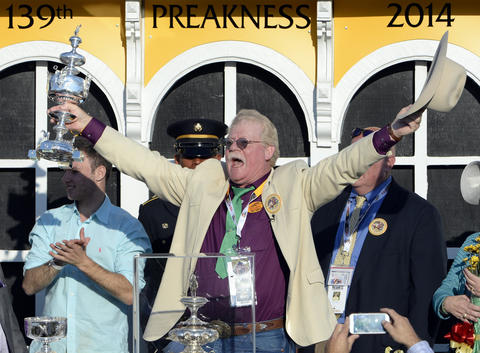Steve Coburn, California Chrome's co-owner, celebrates after the horse won the 139th Preakness at Pimlico Race Course.