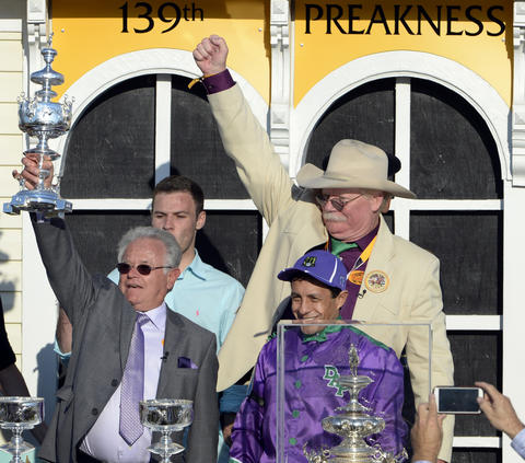 From left to right, trainer Art Sherman, jockey Victor Espinoza and co-owner Steve Coburn celebrate after California Chrome won the 139th Preakness at Pimlico Race Course.