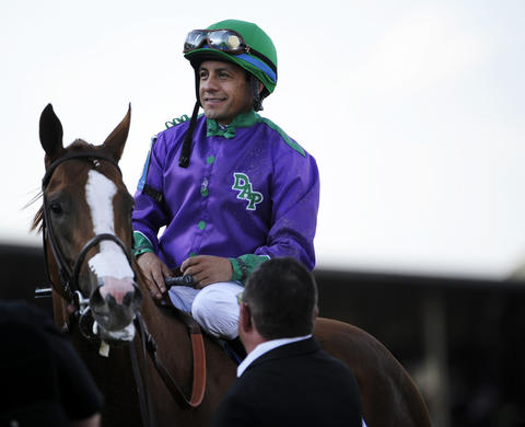 Jockey Victor Espinoza and California Chrome after winning the 139th Preakness at Pimlico Race Course.