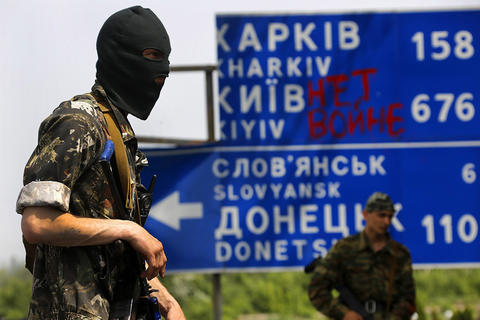 A Pro-Russian militant mans a fortified front line rebel position at a junction near the eastern Ukrainian village of Semenivka on May 19.