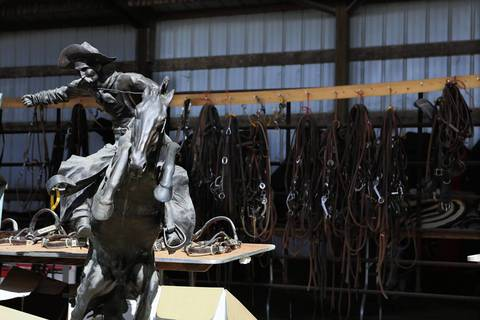 A Remington replica sculpture and harnesses were up for sale on the second day of the federal auction at the Rita Crundwell ranch in Dixon, Ill.