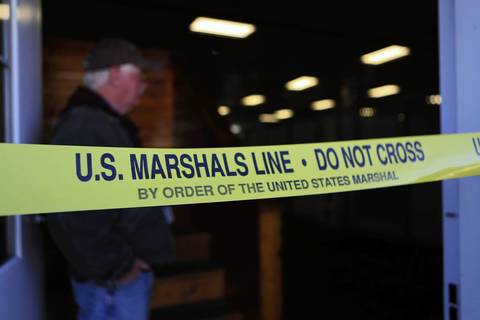 U.S. Marshals' tape blocks many doorways on the second day of the federal auction at the Rita Crundwell ranch in Dixon, Ill.