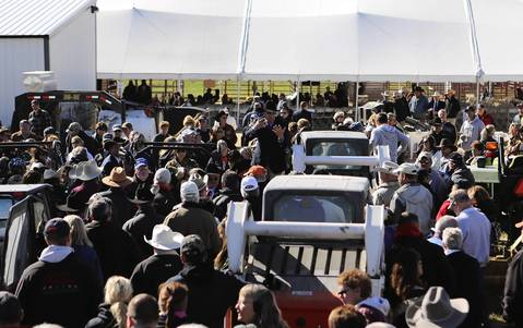 Auctioneers sell ranch equipment on the second day of the federal auction at the Rita Crundwell ranch in Dixon, Ill.