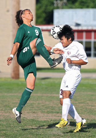 Staff Photo Of The Week: May 10-May 16, 2014     Warwick's Sigar Gurung, right, heads the ball past Great Bridge's Floyd Wilson during the first half of Monday's game at Warwick.